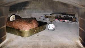 brisket, your wood-fired pizza oven makes a great smoker