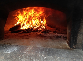 Add wood to pizza oven