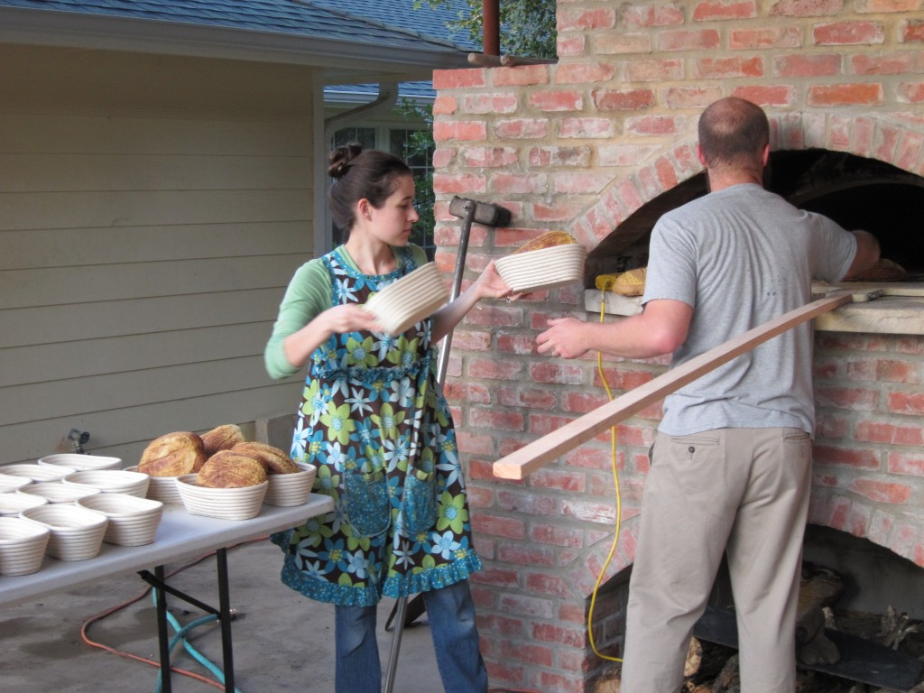 John & Nicole bake bread in a wood-fired oven pizza oven