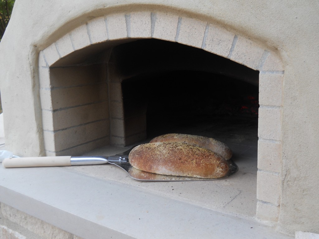 first bread baked in oven, rye bread in wood-fired oven