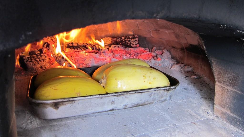 Spaghetti squash roasting in wood-fired oven Texas Oven Co. Austin, San Antonio, Houston