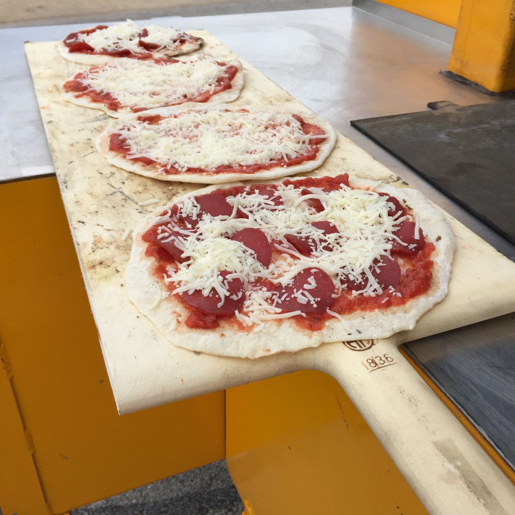 the best pizza dough recipe pepperoni pizza on wooden peel wood-fired oven pizza oven