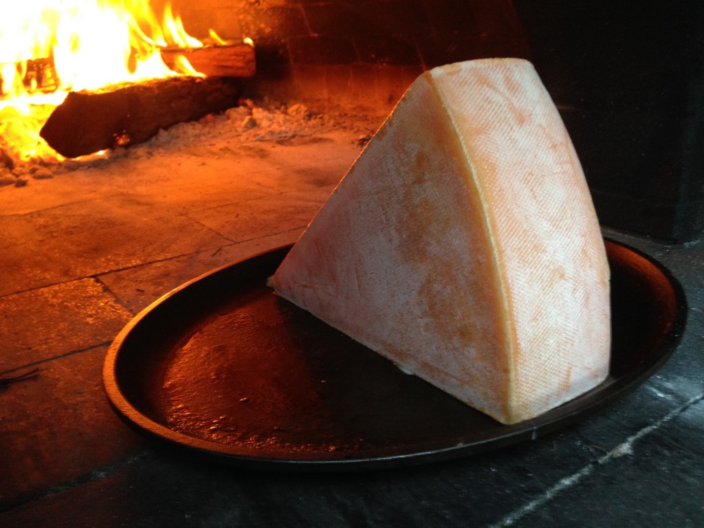 raclette cheese melting in wood fired oven