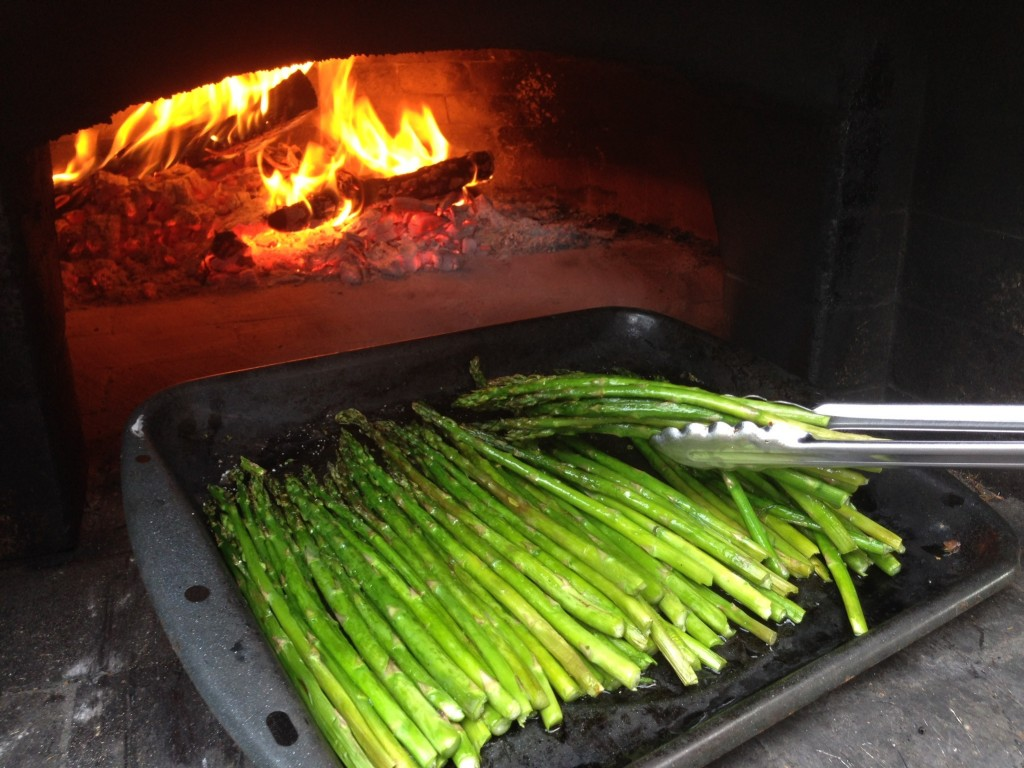 wood-fired asparagus roasted in wood-burning oven pizza oven perfectly done