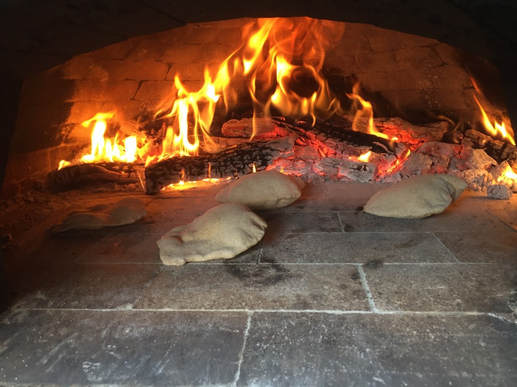 best homemade gyro pita puffing in wood-burining oven