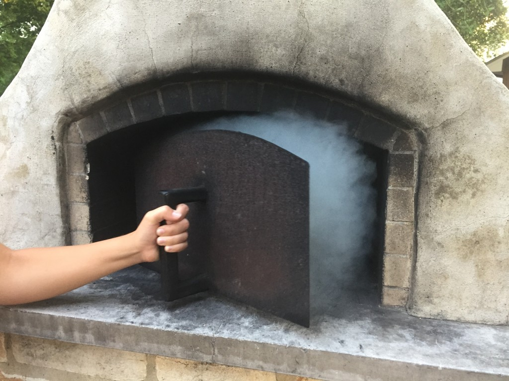 low and slow wood fired oven pizza oven door