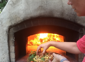 wok pan flavors in wood burning oven