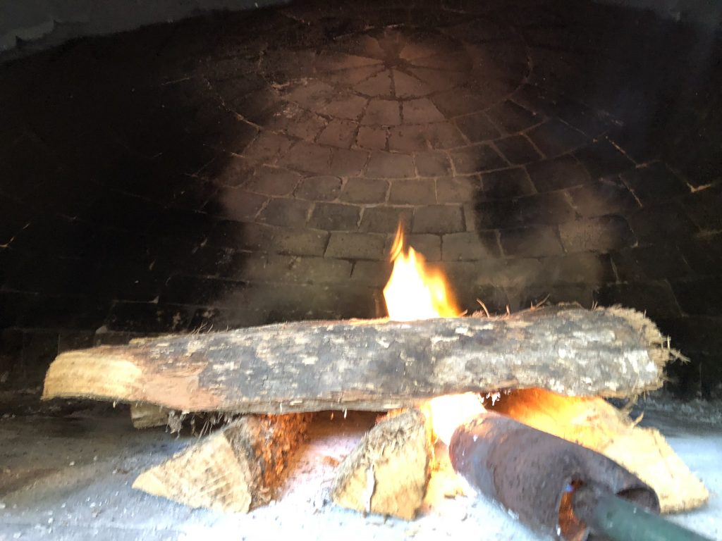 cure an oven by starting a very small fire